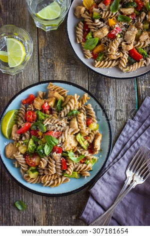 Whole wheat pasta  with chicken and vegetables, top view - stock photo