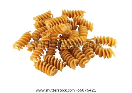 Whole wheat rotini pasta on white background