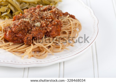 Whole wheat spaghetti with French style cut green beans top view - stock photo