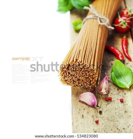 whole wheat spaghetti with ingredients - stock photo