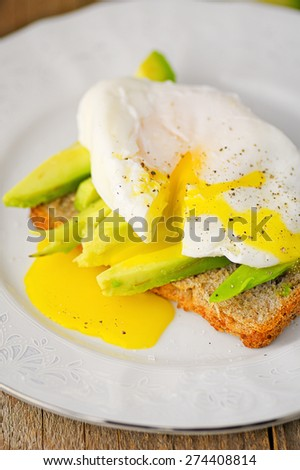 Whole wheat toast with avocado and poached egg - stock photo