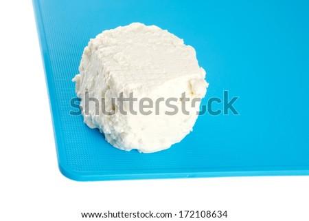 whole white light feta cheese on dishware - stock photo