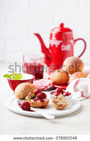 Wholegrain buns and chia seeds strawberry jam for breakfast, selective focus - stock photo