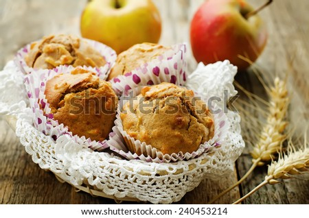 wholegrain muffins with apples on a dark wood background. tinting. selective focus - stock photo