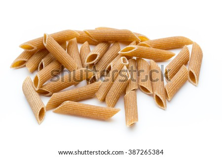 Wholegrain pasta, macaroni pasta close up isolated on white. - stock photo