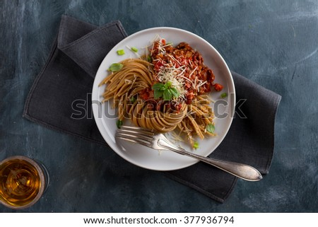 Wholegrain pasta spaghetti with vegetable sauce, selective focus
