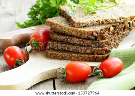 wholegrain rye bread with bran and seeds, healthy eating - stock photo