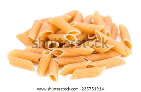 Wholemeal Pasta (Penne) as close-up shot isolated on white background - stock photo