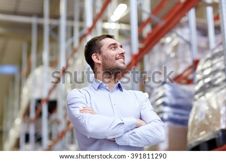 wholesale, logistic, business, export and people concept - happy man at warehouse - stock photo