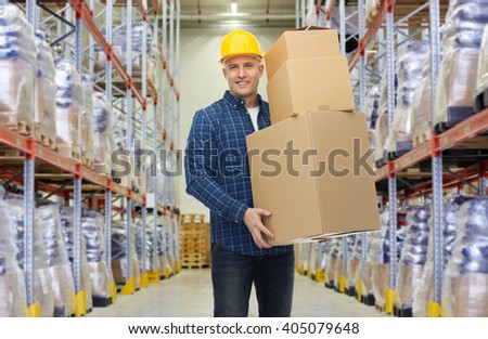 wholesale, logistic, business, export and people concept - happy man or loader in helmet with cardboard box over warehouse background - stock photo