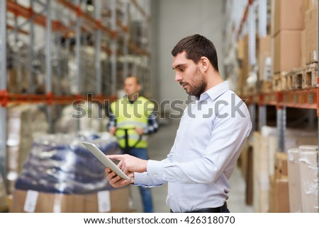 wholesale, logistic, business, export and people concept - man or manager with tablet pc computer checking goods at warehouse - stock photo