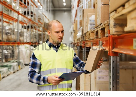wholesale, logistic, people and export concept - man with clipboard and box in reflective safety vest at warehouse - stock photo