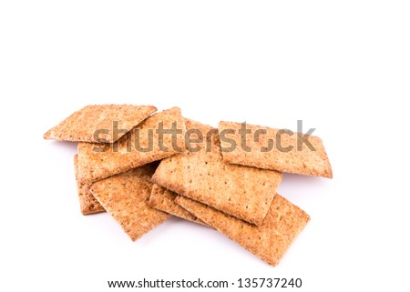Wholesome biscuits with cereal isolated on white. Healthy diet concept.