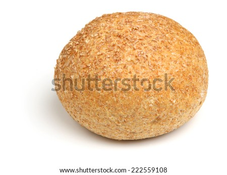 Wholewheat bread roll on white background - stock photo