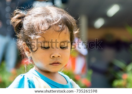 WICHIAN BURI, THAILAND - SEPTEMBER 27,2017: Small thai girl looking direction ground