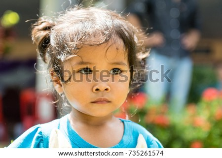 WICHIAN BURI, THAILAND - SEPTEMBER 27,2017: Small thai girl looks past the camera