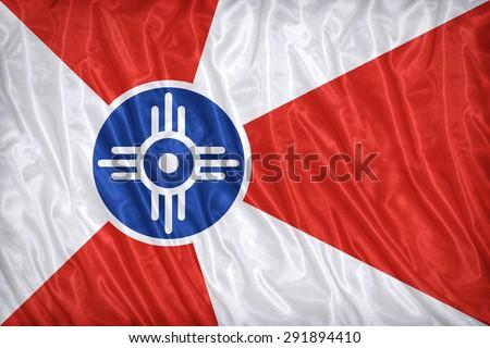 Wichita ,Kansas flag pattern on the fabric texture ,vintage style - stock photo