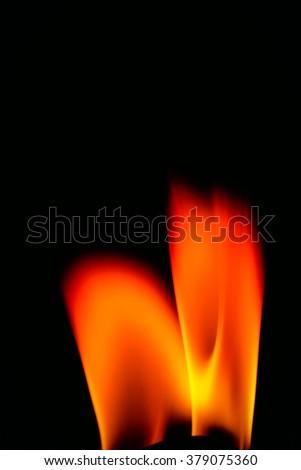 Wick and flame macro on a black background. - stock photo
