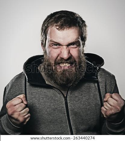 wicked man, anger, bearded man - stock photo