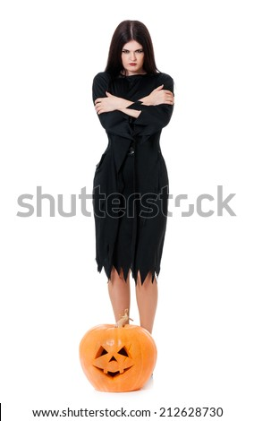 Wicked young witch crossed hands isolated on white background - stock photo
