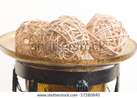 Wicker balls in a glass vase - stock photo