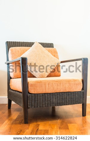 Wicker bamboo chair with pillow on top decoration in room