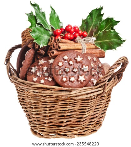 wicker basket full christmas cookie on a white background - stock photo