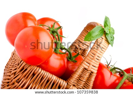 Wicker basket full of delicious tomatoes