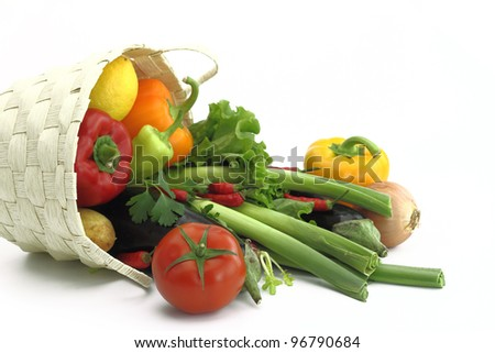 Wicker basket full of fresh vegetables