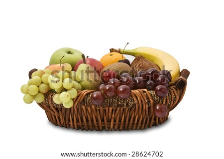 Wicker basket full of fruits isolated on white background. It has a clipping path. - stock photo