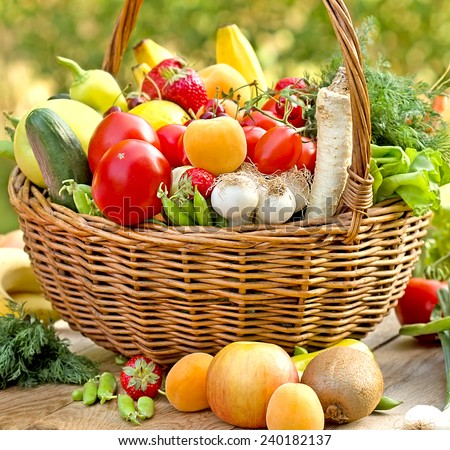 Wicker basket full of healthy food (organic and fresh food)