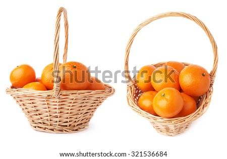 Wicker basket full of multiple ripe orange fresh juicy tangerines, composition isolated over the white background,  set - stock photo
