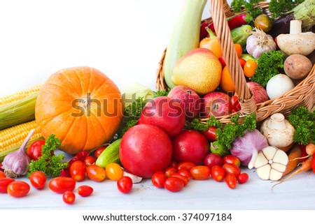 Wicker basket full of organic fruit and vegetables. Healthy eating. - stock photo