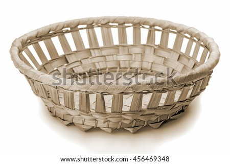 Wicker basket, isolated on white background. The Old style sepia. - stock photo