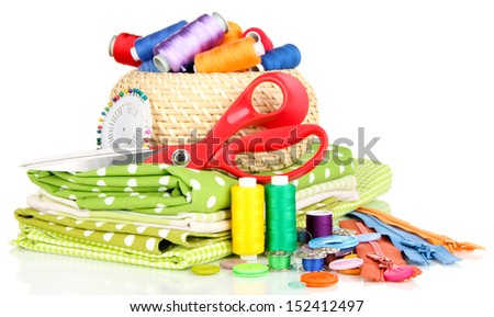 Wicker basket with accessories for needlework isolated on white