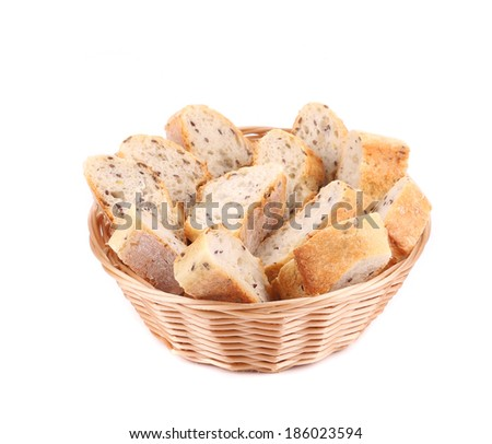 Wicker basket with bread slices. Isolated on a white background. - stock photo