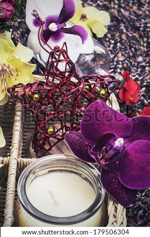 wicker basket with different flowers - stock photo