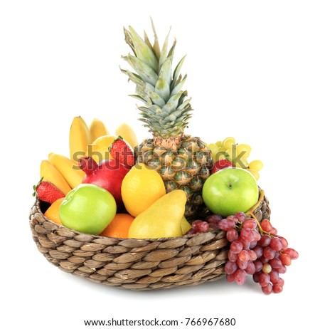 Wicker basket with different fruits on white background
