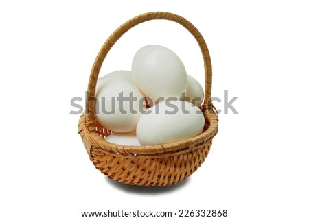 Wicker basket with eggs isolated on white background. - stock photo