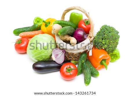 wicker basket with fresh vegetables isolated on white background