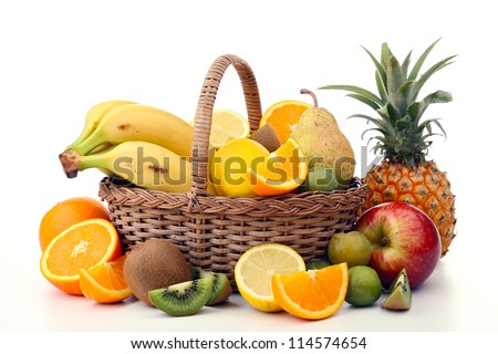 wicker basket with fruits - stock photo