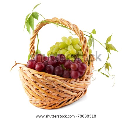 Wicker basket with grapes isolated on white background - stock photo