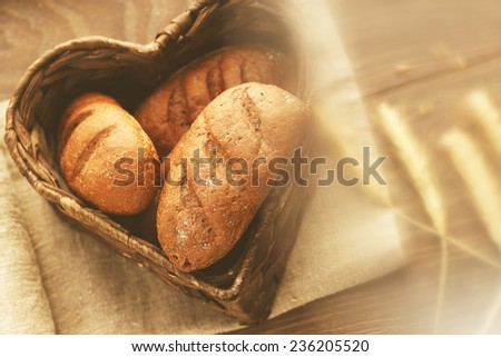 Wicker basket with homemade bread in it - stock photo