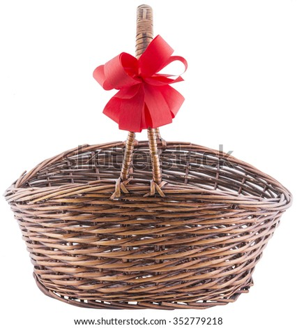 wicker basket with red  bow ribbon. isolated on white background with clipping path.