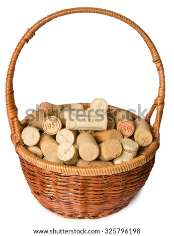 Wicker basket with used wine corks  isolated on white background - stock photo