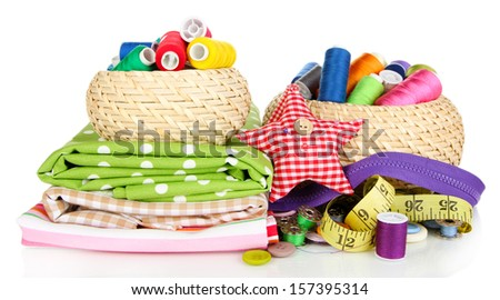 Wicker baskets with accessories for needlework isolated on white