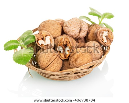 Wicker bowl with walnuts isolated on white background. - stock photo