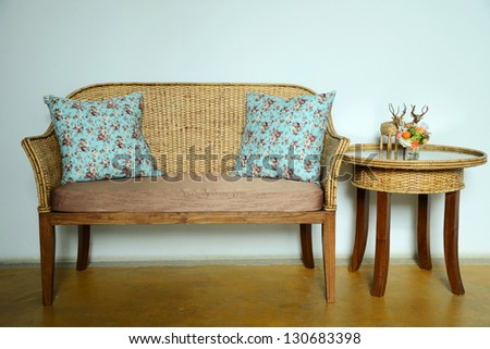 Wicker chair and scatter cushion - stock photo