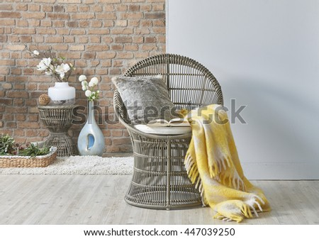 wicker chair and yellow blanket - stock photo