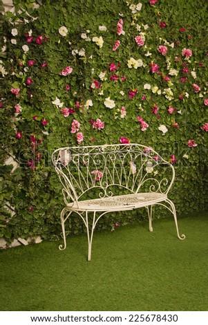 wicker chair in a garden - stock photo